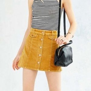 UO BDG yellow button from corduroy skirt